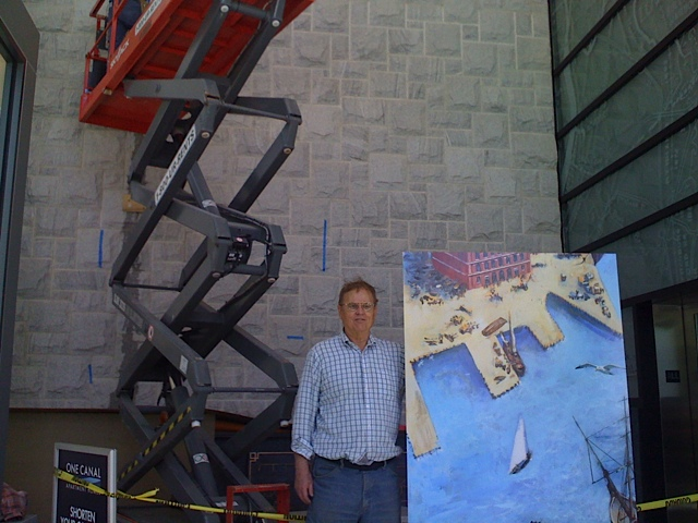 MCA President J Breen holding one panel of Dahill's mural