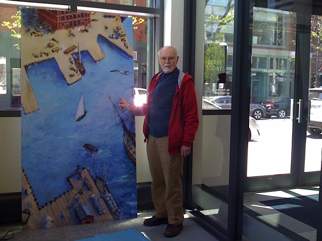 Artist Tom Dahill seeing one of six panels to be hung